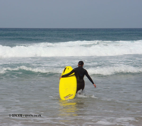 Qin Xie heading out to surf