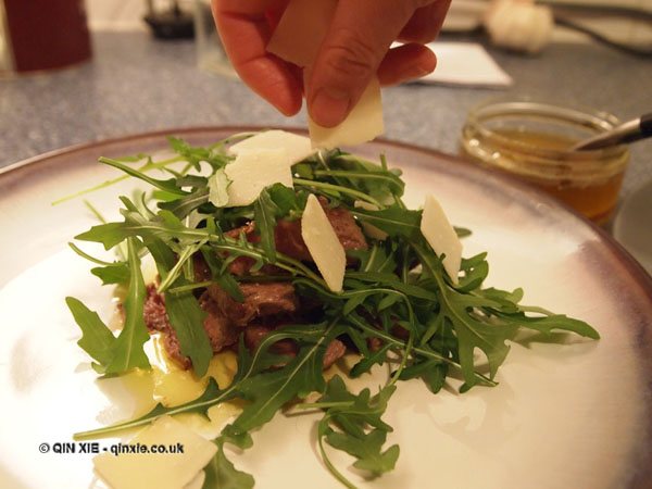 Parmesan over perfect steaks and rocket